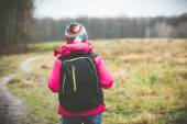 Girl with a backpack g — Stock Photo