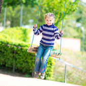 Little girl on swing — Stock Photo