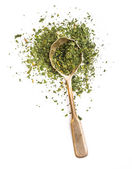 Dried parsley in a spoon — Stok fotoğraf