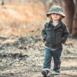 Funny little child walking in the woods — Stock Photo #74237913