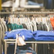 Hangers with mens clothes in shop — Stock Photo #75461839