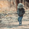 Funny little child walking in the woods — Stock Photo #75463285