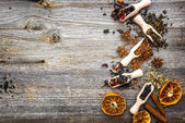 Dry teas on wooden background — Stock Photo