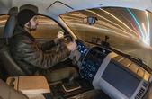 Man driving car at night — Stockfoto