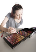 Young Woman Applying Make Up from Large Palette — Stock Photo