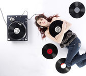 Lying Woman with Vinyl Turnaround and Records — Stock Photo