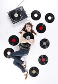 Woman Lying on Floor with Turntable and Records — Stock Photo