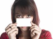 Woman Holding an Empty Card Close to her Face — Stock Photo