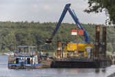 Ship and dredging in the channel — Foto de Stock