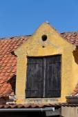 Yellow dormer — Stock Photo