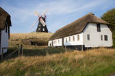 Windmill between houses — Stock Photo