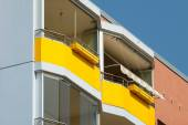 Two yellow balconies — Stockfoto