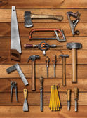 Old carpenter hand tools on wood — Stock Photo