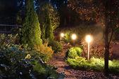 Illuminated garden path patio — Stock Photo