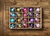 Colorful Xmas balls on old wood background — Stock Photo