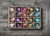 Colorful Xmas balls on old grey wood background — Stock Photo