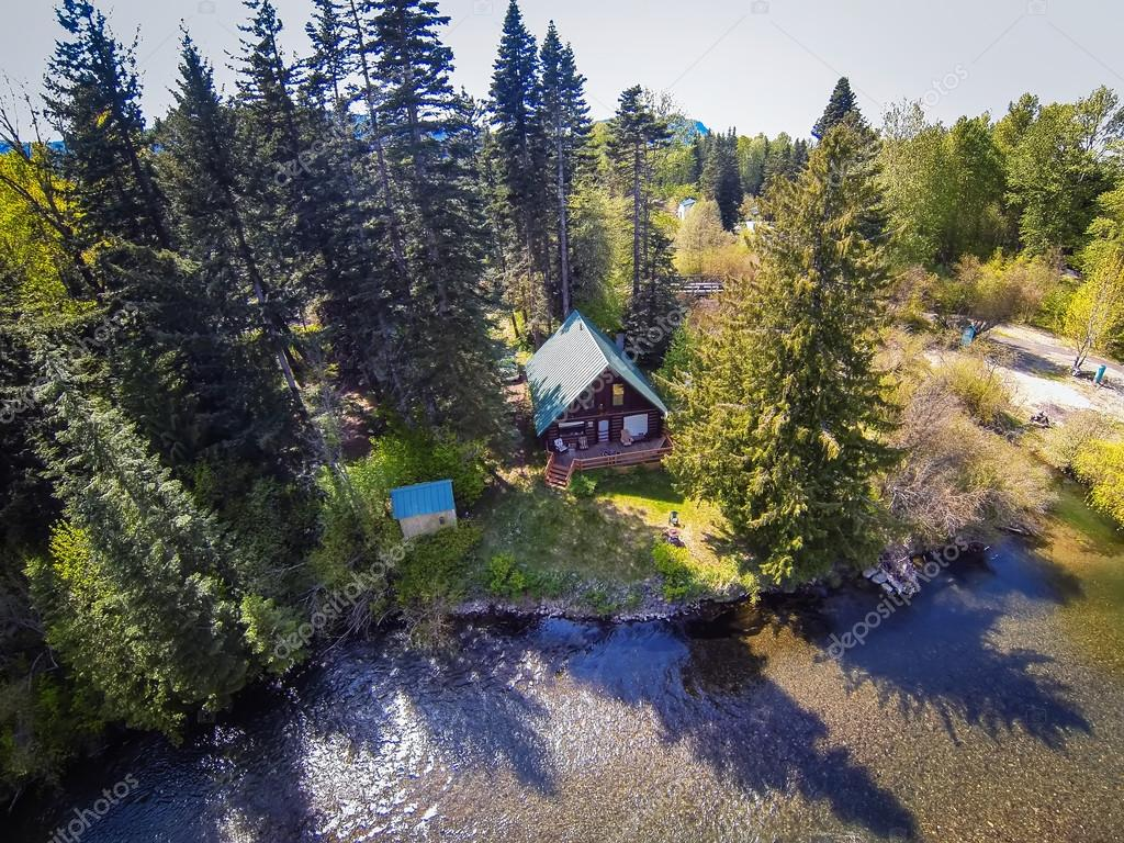 panoramic view of cabin style home on a river bank stock photo panoramic view of cabin style home on a river bank stock photo 116929638