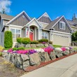 American house with beautiful landscape and vivid flowers — Stock Photo #51925567