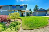 American house with landscaped front yard and garage — Stock Photo