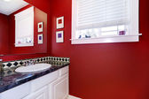 Bathroom with bright red walls — Stock Photo