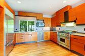 Modern bright orange kitchen room — Stock Photo
