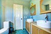 Bathroom vanity cabinets with vessel sinks and round mirrors — Zdjęcie stockowe