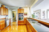 Modern kitchen interior in spacious house — Stok fotoğraf