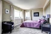 Bedroom in grey tones with purple bed — Stock Photo