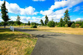 Countryside landscape. Private driveway to farm house — Stock Photo