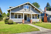 Clapboard siding house exterior. Large entance porch with brick  — Stock Photo