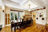 Empressive dining room interior. Luxury house with wood trim — Stock Photo