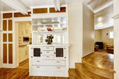 Beautiful white cabinet serving as a wall between dining and kit — Stock Photo