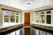 Foyer with black shiny tile floor and stone trim under the windo — Stock Photo