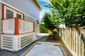 Small deck with white railings and orange trim — Stock Photo