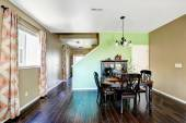 Dining room with beige and green color walls — Stock Photo