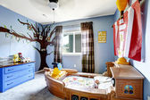 Cheerful kids room with boat bed — Stockfoto