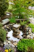 Ideas for landscaping home garden. Fountain with rocks — Photo