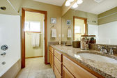 Bathroom vanity cabinet with granite top and mirror — Stock Photo