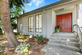 Entrance porch with red door — Foto Stock
