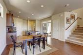 Kitchen room with dining area and walkout deck — Stock fotografie