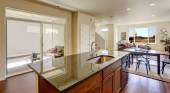 House interior with open floor plan. Kitchen island with granite — Stock Photo