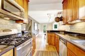 Kitchen room with black granite tops and tile back splash trim — Stock Photo