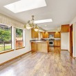 Empty house with open floor plan. Living room and kitchen area — Stok fotoğraf