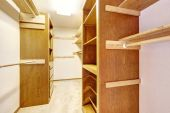 Empty walk-in closet with cabinets — Stock Photo