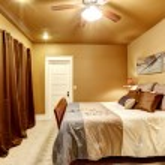Warm tones bedroom with beautiful bed — Stock Photo #53535235