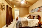 Warm tones bedroom with beautiful bed — Stock Photo