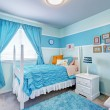 Charming girls room interior in blue tones — Stock Photo #53603411