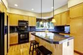 Kitchen with black appliances — Stock Photo