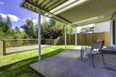Backyard patio with walkout deck — Stock Photo