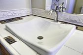 Sink with steel faucet. Close up view — Stock Photo